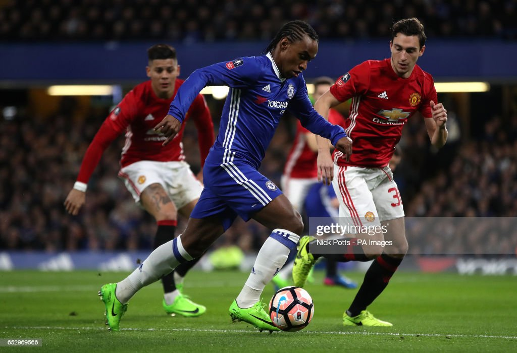 Chelsea's Victor Moses and Manchester United's Matteo Darmian (right) battle for the ball during the Emirates FA Cup, Quarter Final match at Stamford Bridge, London.