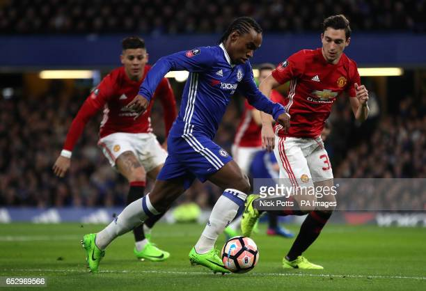 Chelsea's Victor Moses and Manchester United's Matteo Darmian battle for the ball during the Emirates FA Cup Quarter Final match at Stamford Bridge...