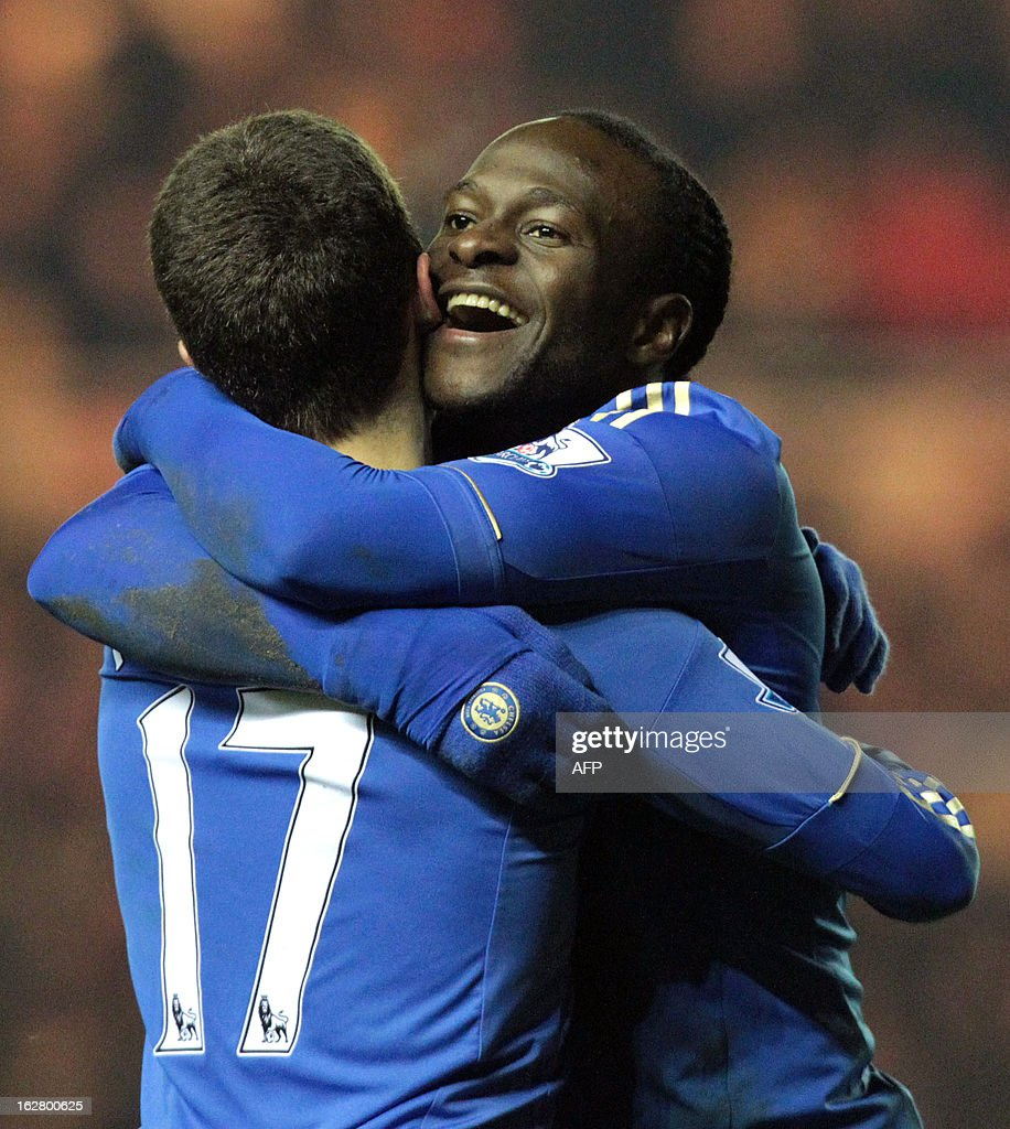 """Chelsea's Victor Moses (R) celebrates scoring the second goal with teammate Eden Hazard during the English FA Cup fifth round football match between Middlesbrough and Chelsea at the Riverside stadium in Middlesbrough, northeast England, on February 27, 2013. USE. No use with unauthorized audio, video, data, fixture lists, club/league logos or """"live"""" services. Online in-match use limited to 45 images, no video emulation. No use in betting, games or single club/league/player publications."""