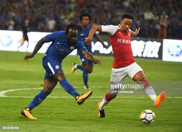 Chelsea's Victor Moses shoots for goal as Arsenal's Cohen Bramall challenges during their friendly football match at Beijing's National Stadium known...