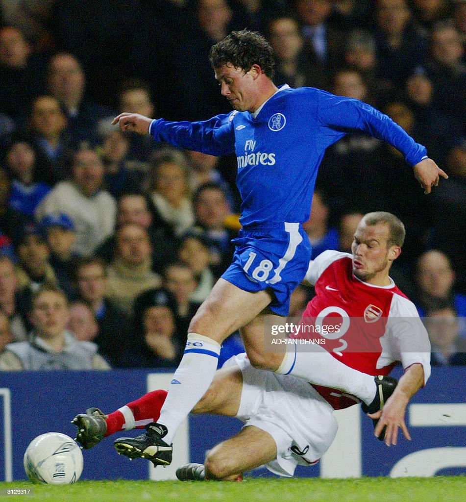 Chelsea's Wayne Bridge (L) avoids a tackle from Arsenal's Fredrik Ljungberg during their Champions League quarter-final football match 24 March, 2004 at Stamford Bridge, London. Chelsea and Arsenal tied 1-1.