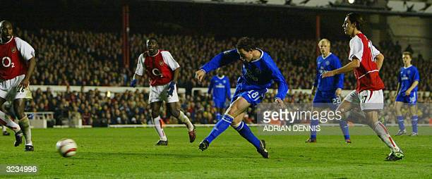 Chelsea's Wayne Bridge scores the winning goal as Arsenal's Sol Campbell Kanu and Robert Pires watch during their Champions League quarterfinal...