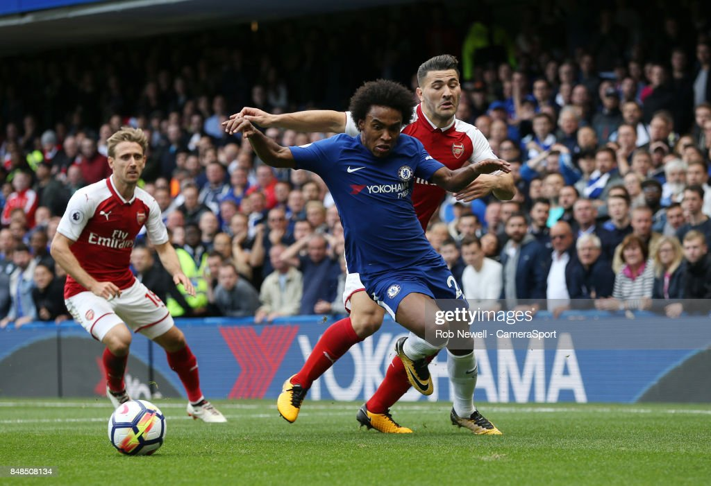 Chelsea's Willian and Arsenal's Sead Kolasinac during the Premier League match between Chelsea and Arsenal at Stamford Bridge on September 17, 2017 in London, England.
