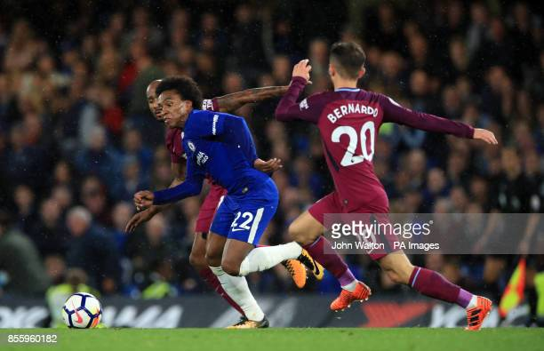 Chelsea's Willian and Manchester City's Bernado Silva battle for the ball during the Premier League match at Stamford Bridge London