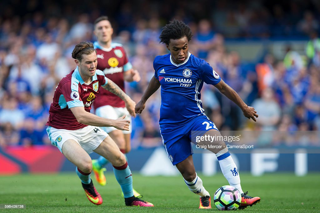 Chelsea's Willian evades the challenge of Burnley's Aiden O'Neill during the Premier League match between Chelsea and Burnley at Stamford Bridge on...
