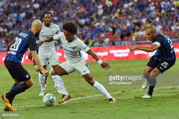 Chelsea's Willian fights for the ball with Inter Milan's Borja Valero and Joao Miranda during their International Champions Cup football match in...
