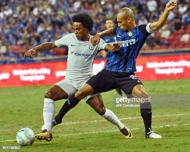 Chelsea's Willian fights for the ball with Inter Milan's Joao Miranda during their International Champions Cup football match in Singapore on July 29...