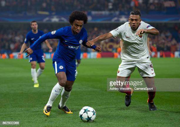 Chelsea's Willian holds off the challenge from Roma's Juan Jesus during the UEFA Champions League group C match between Chelsea FC and AS Roma at...