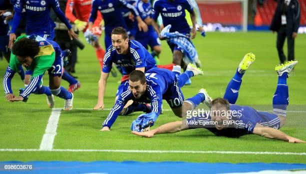 Chelsea's Willian Nemanja Matic Eden Hazard and Chelsea's Branislav Ivanovic dive on the pitch whilst celebrating their win