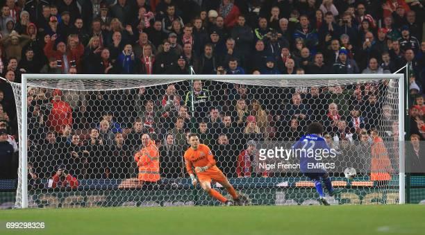 Chelsea's Willian scores his penalty past Stoke City goalkeeper Jack Butland