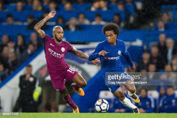 Chelsea's Willian vies for possession with Manchester City's Fabian Delph during the Premier League match between Chelsea and Manchester City at...