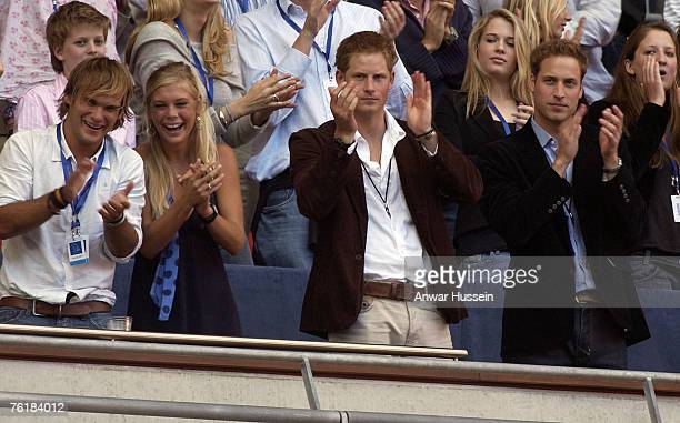 Chelsy Davy Prince Harry and Prince William watch the Concert for Diana from the Royal box at Wembley Stadium on July 1 2007 in London England