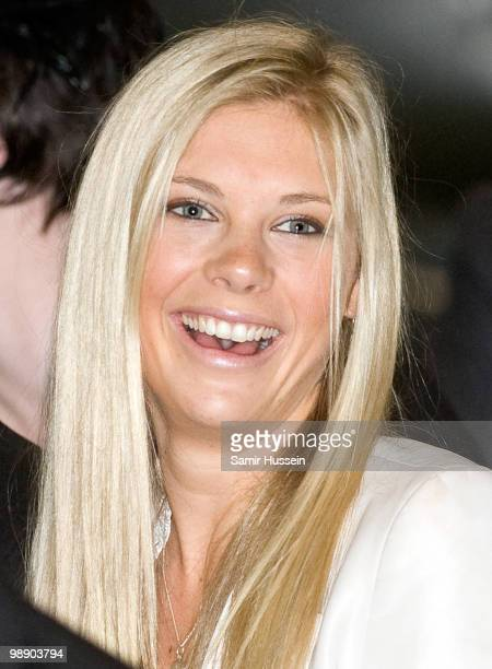 Chelsy Davy watches Prince Harry with his flying badges at the Museum of Army Flying on May 7 2010 in Middle Wallup England