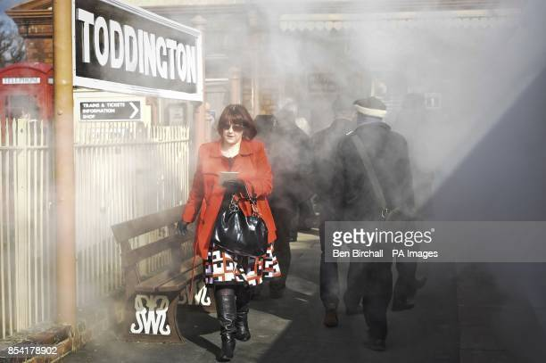 Cheltenham racegoers pass through steam as they rush to board steam train carriages to transport them to the festival in style aboard the At The...
