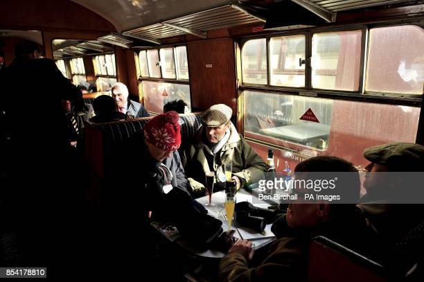 Cheltenham racegoers relax in a carriage aboard and transport them to the festival in style aboard the At The Races Express trains