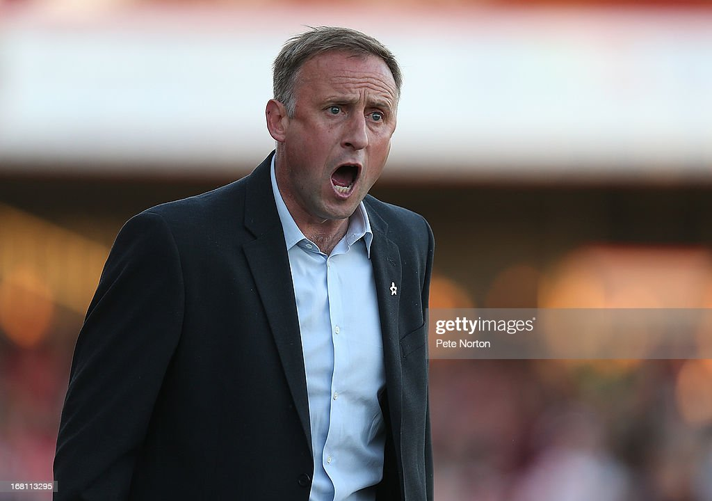 Cheltenham Town manager Mark Yates gives instructions during the npower League Two Play Off Semi Final Second Leg between Cheltenham Town and Northampton Town at Abbey Business Stadium on May 5, 2013 in Cheltenham, England.