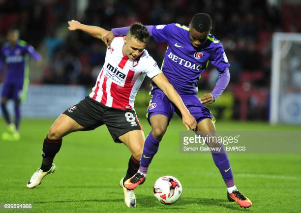Cheltenham Town's Billy Waters and Charlton Athletic's Ademola Lookman in action
