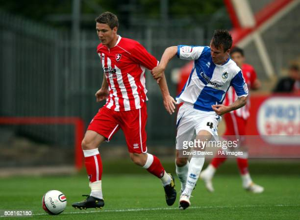 Cheltenham Town's Jeff Goulding is challenged by Bristol Rovers' Chris Lines during the preseason friendly at the The Abbey Business Stadium...