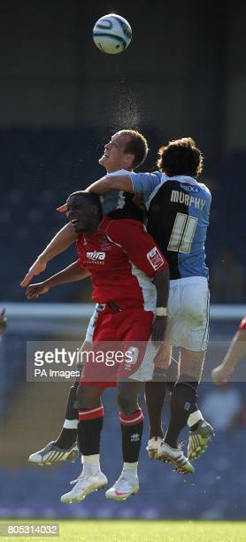 Cheltenham Town's Justin Richards is out jumped by Bury's Brian BarryMurphy and Bury's Ben Futcher during the CocaCola League Two match at Gigg Lane...