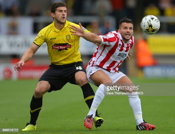 Cheltenham Town's Paul Black competes for the ball with Burton Albion's John Mousinho left