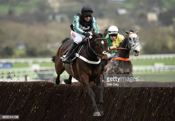 Cheltenham United Kingdom 14 March 2017 Altior left with Nico de Boinville up jumps the last on their way to winning the Racing Post Arkle Challenge...