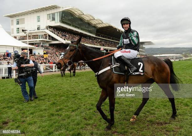 Cheltenham United Kingdom 14 March 2017 Nico de Boinville celebrates winning the Racing Post Arkle Challenge Trophy Novices' Steeple Chase on Altior...
