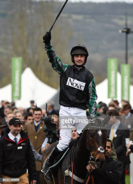 Cheltenham United Kingdom 14 March 2017 Nico de Boinville celebrates as he enters the winners enclosure after winning the Racing Post Arkle Challenge...