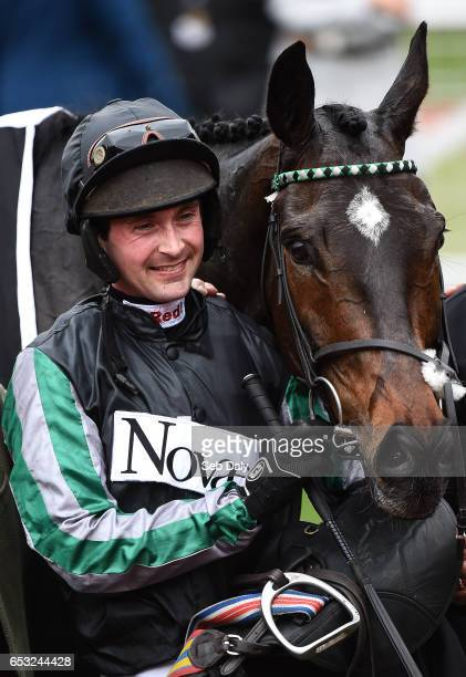 Cheltenham United Kingdom 14 March 2017 Nico de Boinville with horse Altior after winning the Racing Post Arkle Challenge Trophy Novices' Steeple...