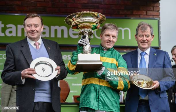 Cheltenham United Kingdom 14 March 2017 Trainer Nicky Henderson left jockey Noel Fehily centre and owner JP McManus after winning the Stan James...