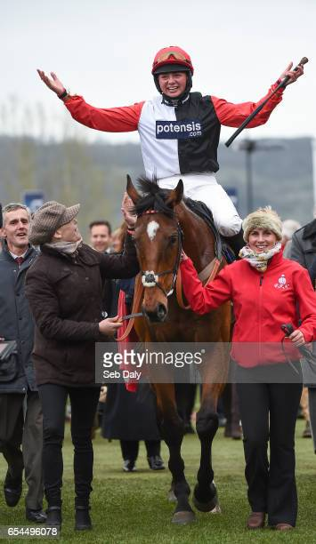 Cheltenham United Kingdom 17 March 2017 Jockey Bryony Frost celebrates as she enters the winners enclosure after winning the St James's Place...