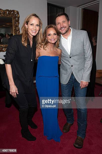 Chely Wright Kristin Chenoweth and Ty Herndon pose backstage after the 'I Am Harvey Milk' Benefit Concert at Avery Fisher Hall Lincoln Center on...