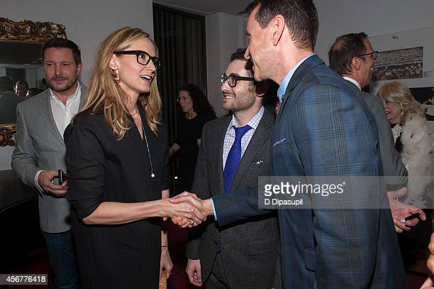 Chely Wright shakes hands with Andrew Lippa backstage after the 'I Am Harvey Milk' Benefit Concert at Avery Fisher Hall Lincoln Center on October 6...