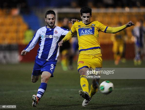 Chema of AD Alcorcon clears the ball ahead of a tackle from Sergio Garcia of Espanyol during the Copa del Rey Round of 16 1st leg match between...