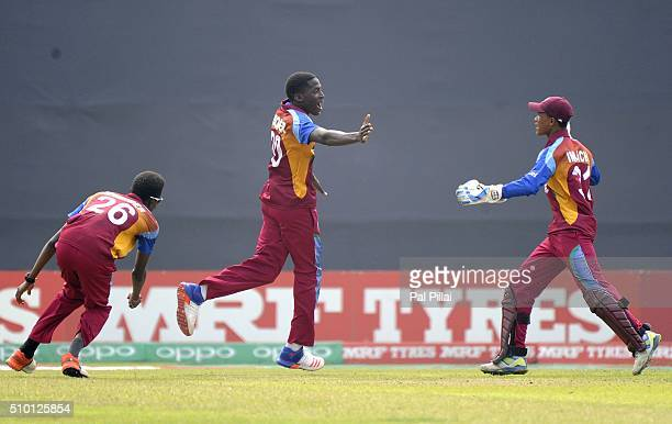 Chemar K Holder of West Indies U19 celebrates the wicket of Mahipal Lomror of India during the ICC U19 World Cup Final Match between India and West...