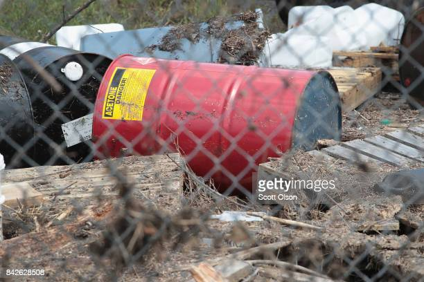 Chemical drums that had washed away from the Arkema plant during flooding caused by Hurricane and Tropical Storm Harvey are trapped by the facilities...