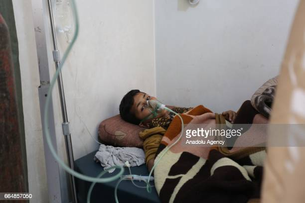 A chemical gas attack survivor 9yearsold boy Hassan Dallal receives medical treatment at an hospital Maarrat alNu'man Town of Idlib Syria on April 05...