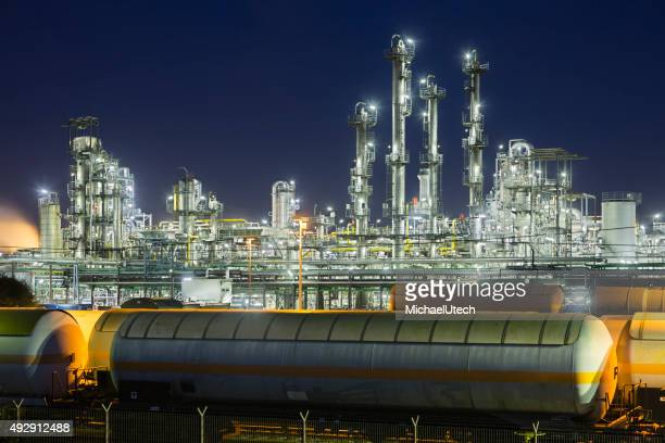 Chemical Plant And Railroad Cars At Night
