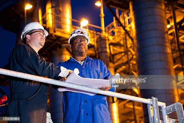 Chemical plant workers at night