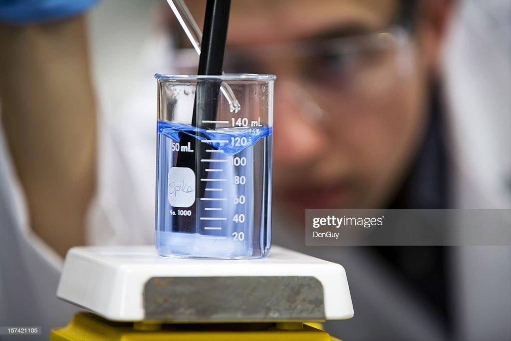 Chemist in Lab Focus on Beaker Close Up