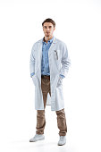 young male chemist in white coat, isolated on white