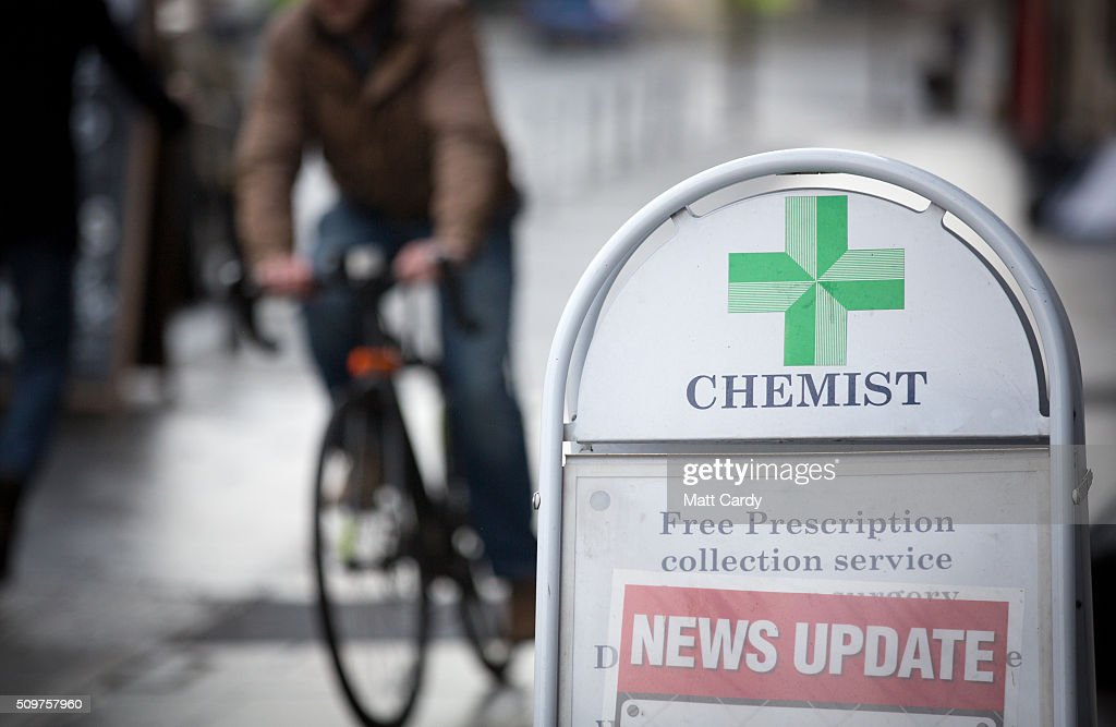 A chemist sign is displayed outside a independent chemist shop on February 12, 2016 in Bath, England. One in four high street pharmacies could close as the Government cuts £170 million from the prescription handling fees paid to them.