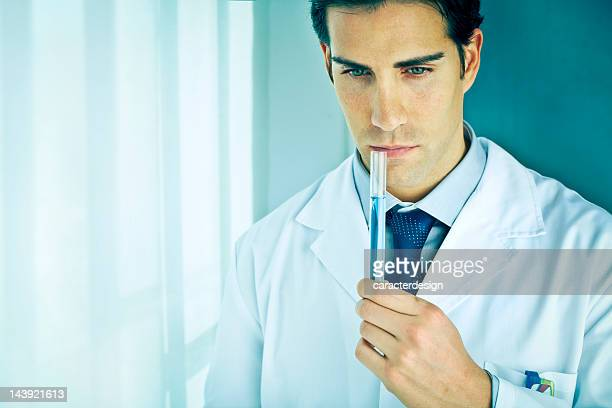 Chemist smelling potion in laboratory