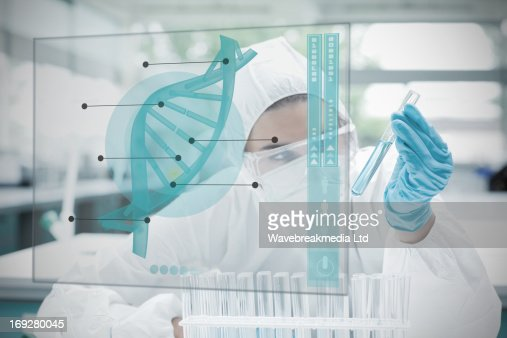 Chemist working cautiously with blue liquid and futuristic interface : Stock-Foto