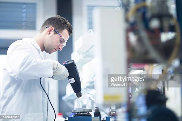 Chemist working in lab drying a sample