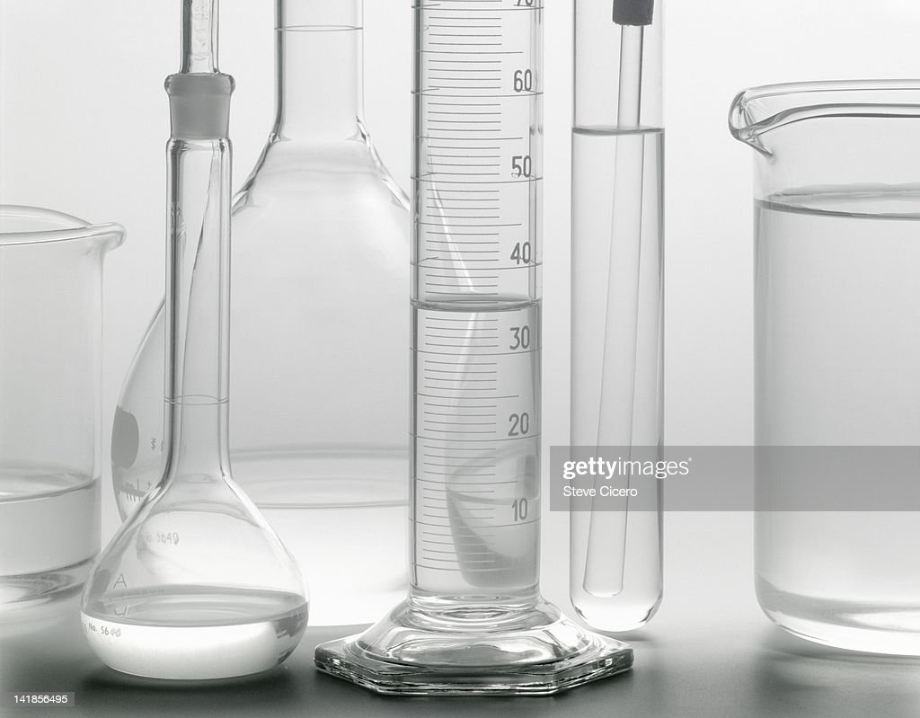 Chemistry flasks with liquids : Stock Photo