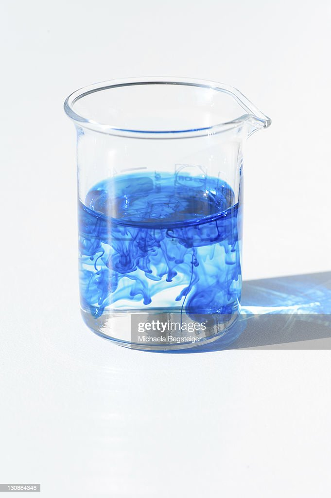 Chemistry Lab Measuring Cup Beaker Glass With Blue Food Coloring ...
