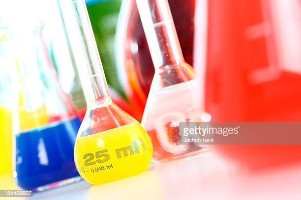 Chemistry laboratory, various glass containers with liquids, chemicals, in various colors