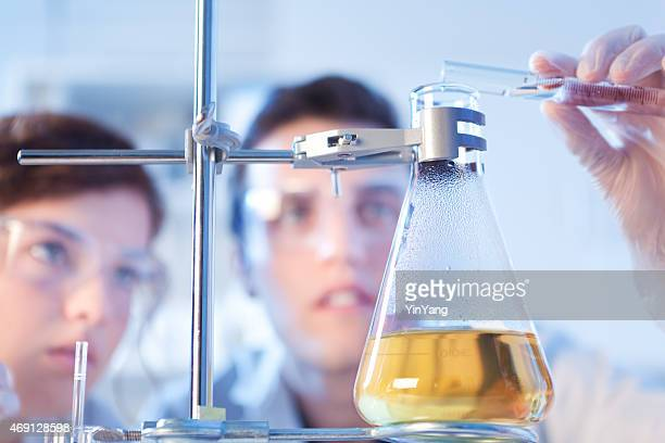 Chemistry Science Research Scientist Students Working in Laboratory Experiment