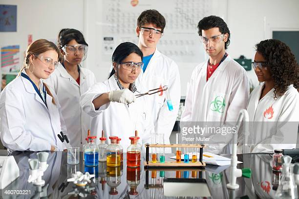 Chemistry teacher and students doing experiment