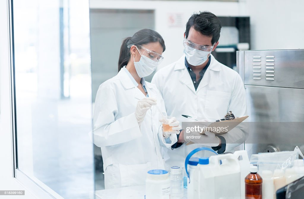Chemists working at a the lab : Stock Photo